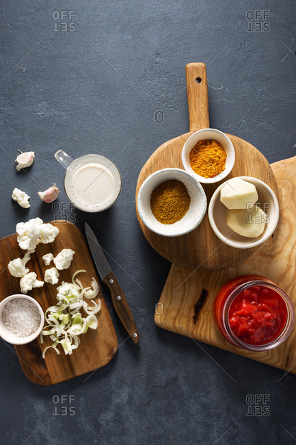 Raw ingredients for cooking cauliflower curry