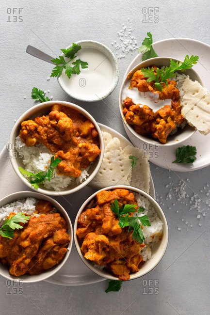 Indian vegan bowl with rice and brown cauliflower