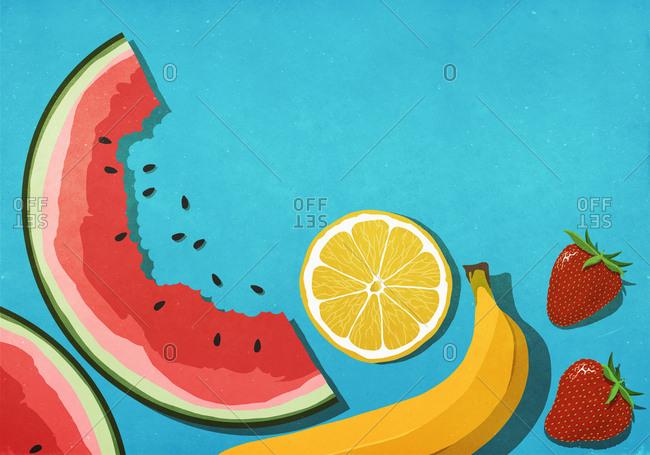 Fresh, juicy fruits on blue background