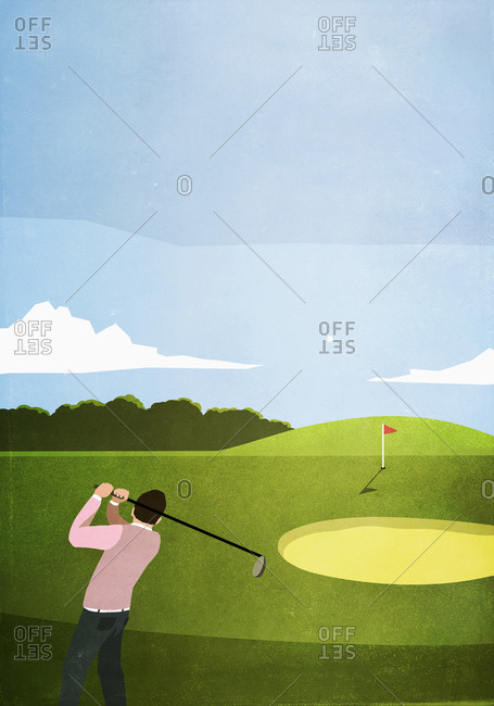 Man golfing on sunny golf course