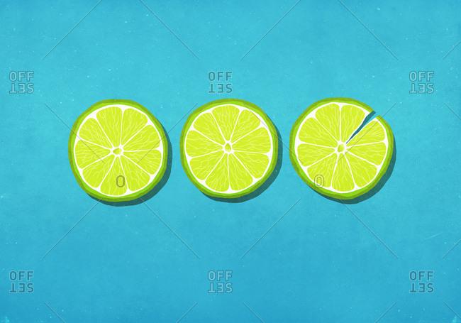 Vibrant green lime slices on blue background