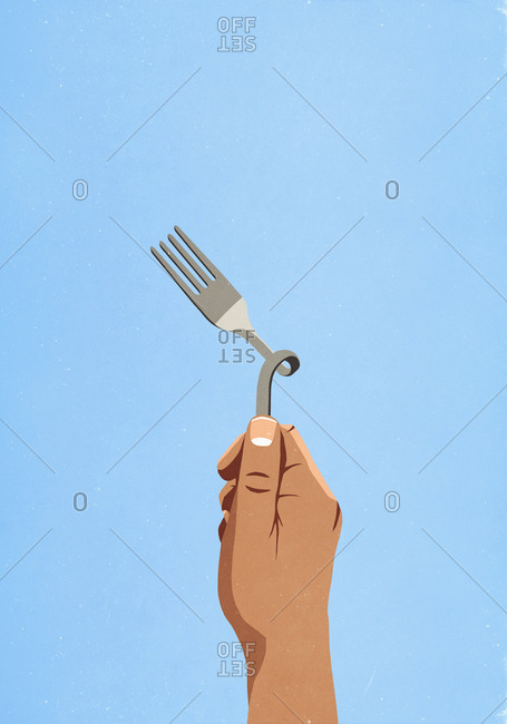 Hand holding twisted fork