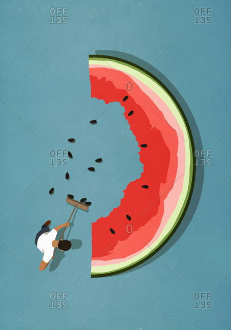 Man with broom sweeping seeds from large watermelon slice