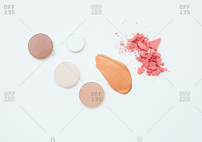 Flatlay of makeup products on a white background