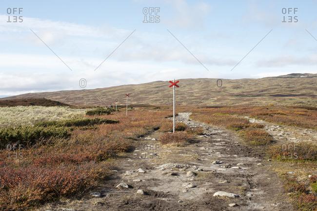 Hiking trail maker in field
