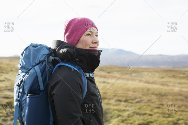 Woman hiking in field