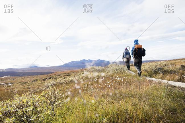 Women hiking through field