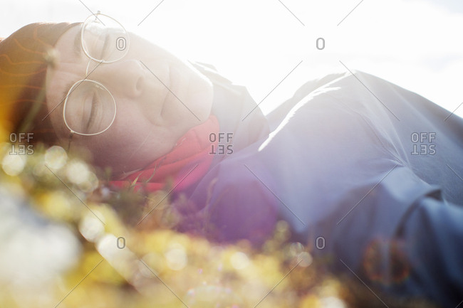 Woman napping in sunlight - Offset