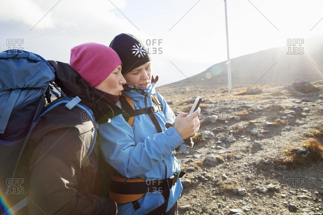 Women using smart phone during hike