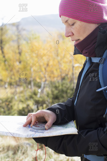 Woman using compass and map