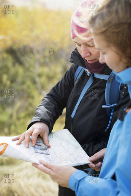 Women using compass and map