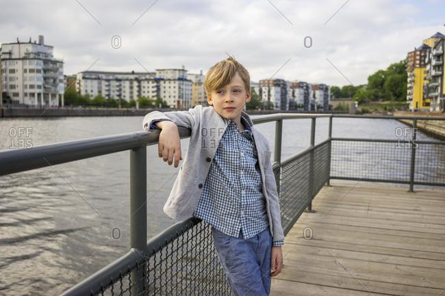 Boy posing next to a river