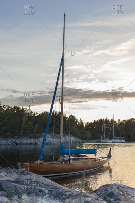 Moored boat at Stockholm archipelago during sunset