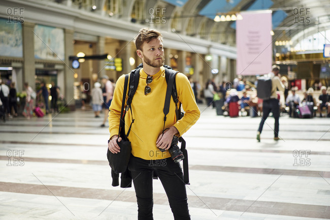 Tourist wearing yellow sweater in Stockholm Central Station,  Stockholm,  Sweden