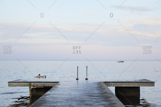Pier on Vattern lake at sunset in Hjo,  Sweden