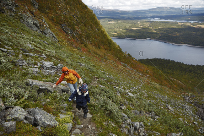 Grandmother and grandson hiking on mountain