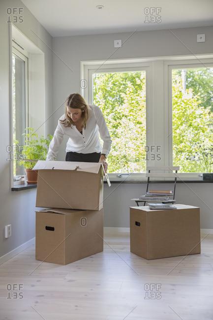 Woman unpacking cardboard box