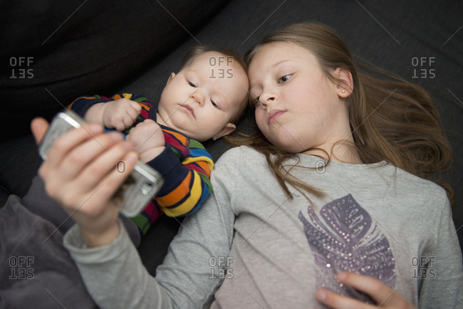 Sisters looking at smart phone