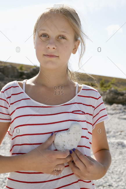 Girl with heart shape stone