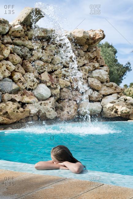 Girl resting poolside