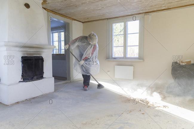 Mature woman renovating house