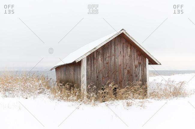Wooden barn in snow