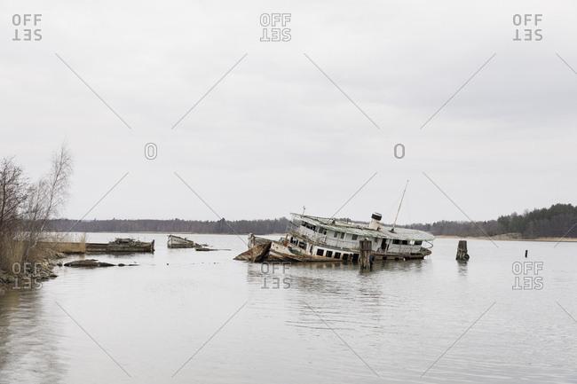 Ostergotland, Sweden - April 9, 2018: Shipwreck on river