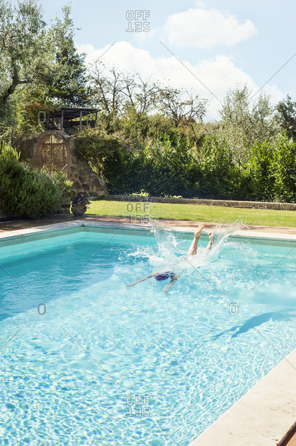 Woman diving into swimming pool