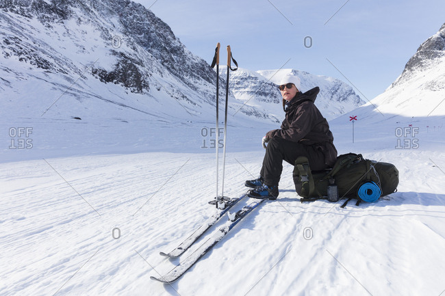 Woman resting on Kungsleden trail in Lapland,  Sweden