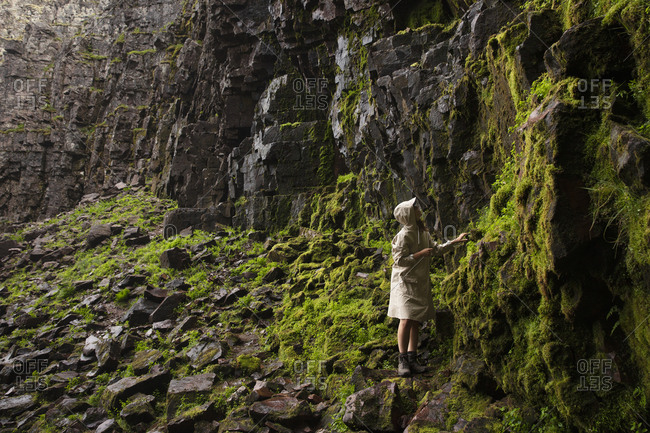 Woman by cliff in Fulufjallet National Park,  Sweden