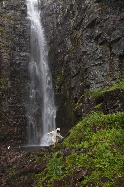 Woman by Njupeskar waterfall in Fulufjallet National Park,  Sweden