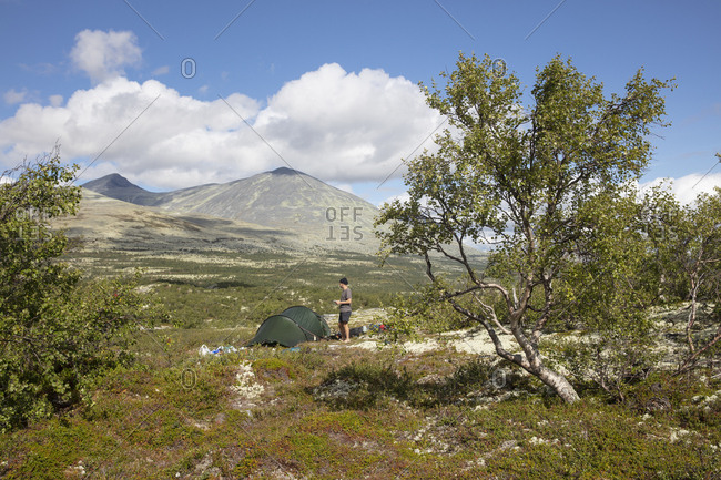 Man by his tent in Rondane National Park,  Norway