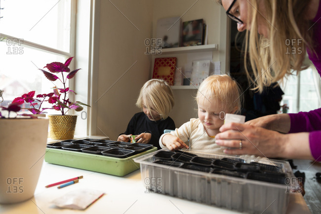 Mother and children with plant pots
