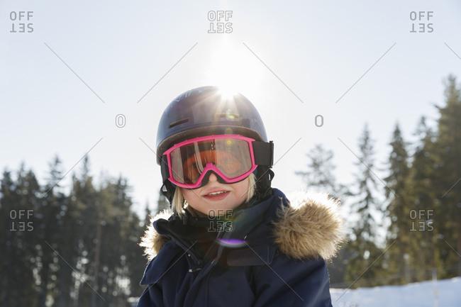Girl wearing ski goggles and helmet