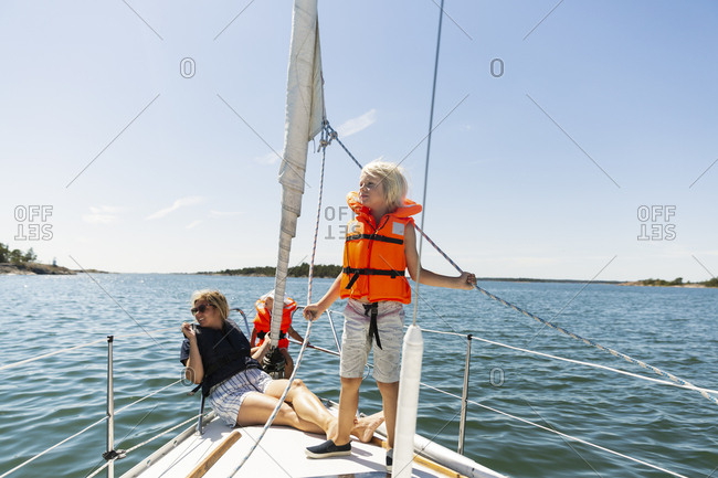 Mother with her children on yacht