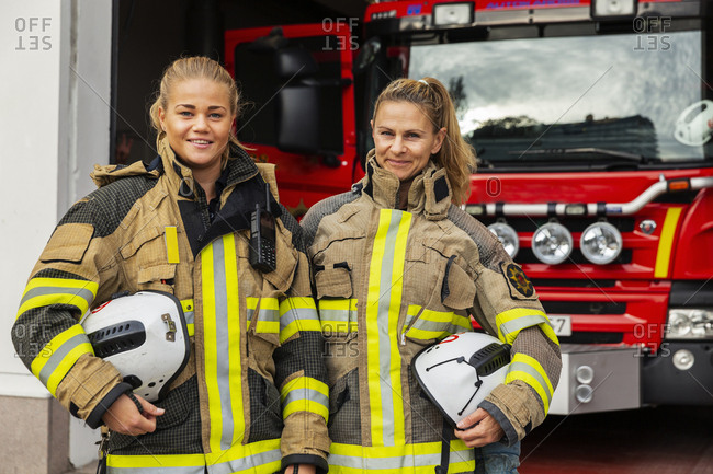 Female firefighters by fire engine