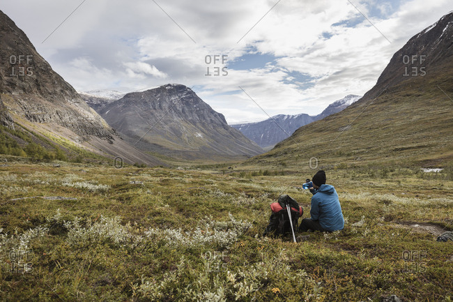 Mid adult man sitting on plateau in Norrbotten,  Sweden