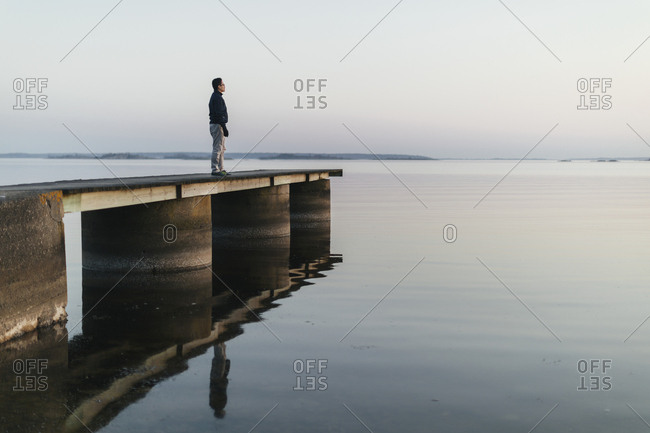 Man standing on jetty