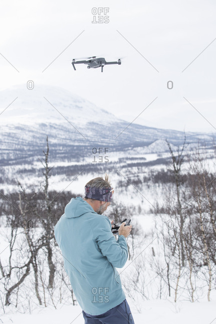 Man using drone in snow