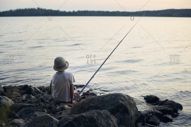 Boy fishing in lake