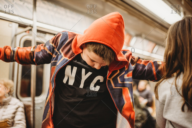 Siblings ride the subway together in NYC