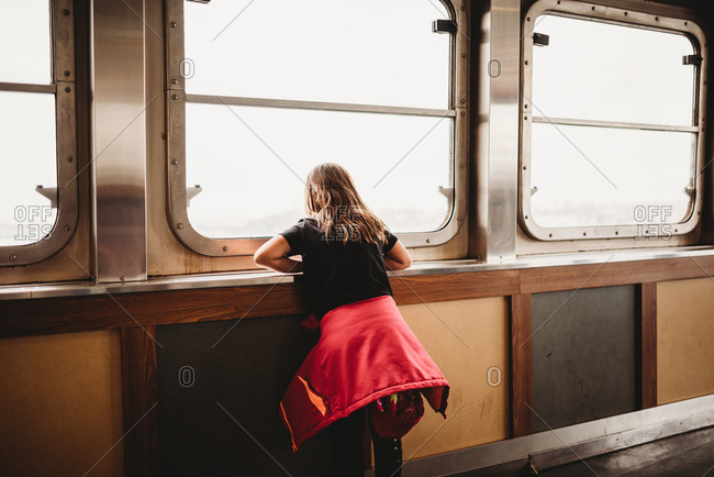 Girl on ferry stares out the window