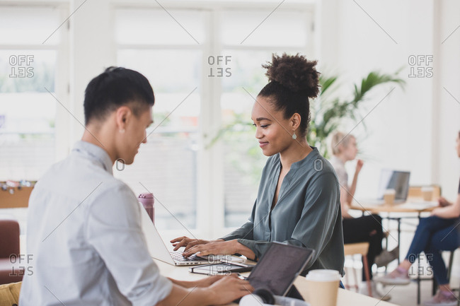 African American Woman working in a coworking space