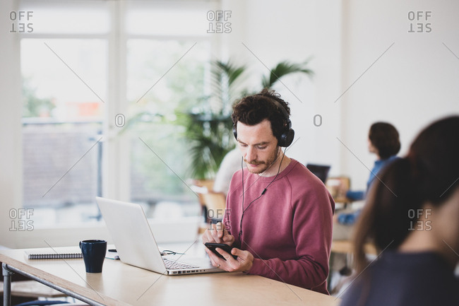 Freelance male working in a coworking space