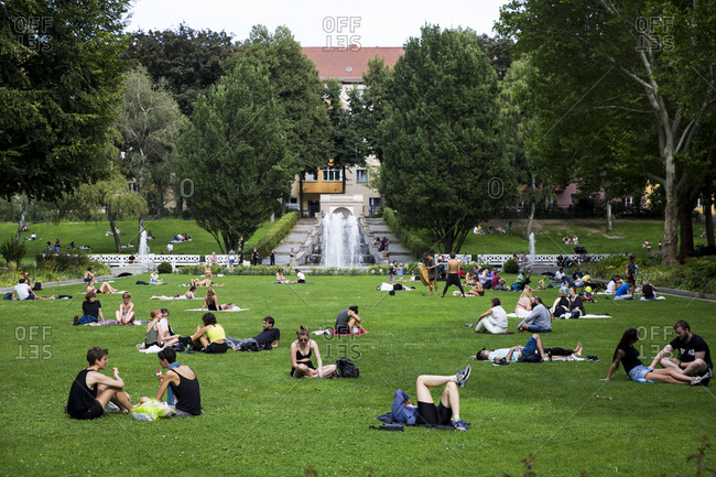 Berlin, Germany - August 9, 2019: People relax on a summer's day in Kornerpark in the Neukolln area.