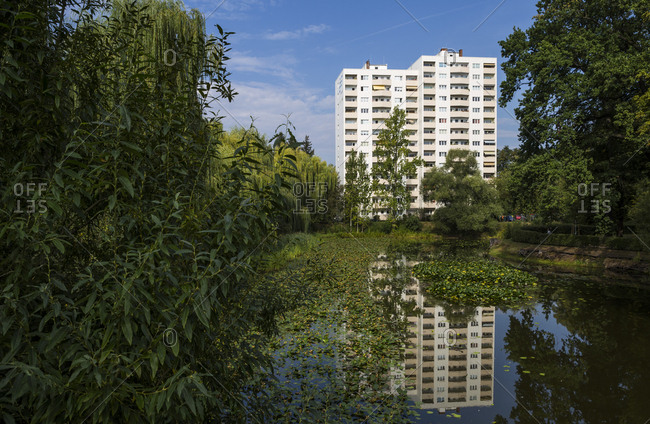 Berlin, Germany - August 27, 2019: Reflection of an apartment building reflected in a lily pond.