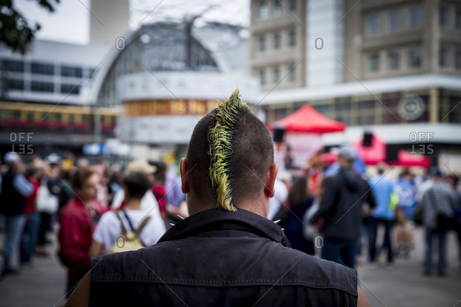 A punk waits for a demonstration to begin in Alexanderplatz, Berlin, Germany