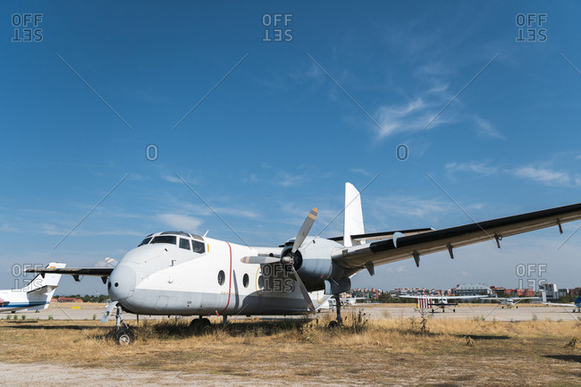 Madrid, Spain - September 1, 2019: Side view of old abandoned propeller plane