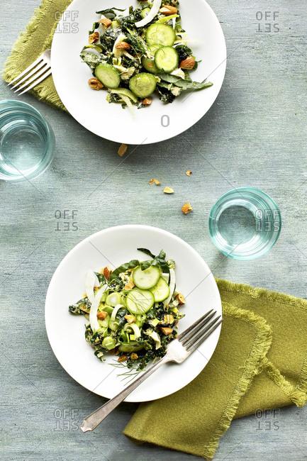 Kale veggie salad with roasted leek pesto served on two plates