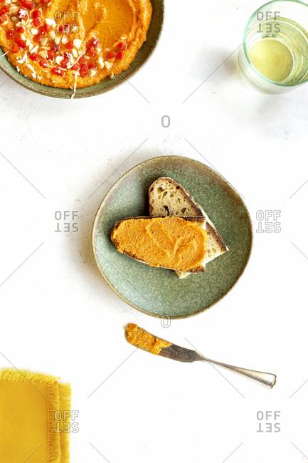 Creamy roasted red pepper pesto spread on bread